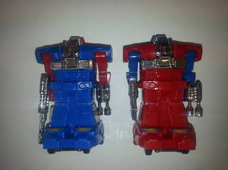 Transformer Robots  1 x Red & 1 x Blue 80 x 50mm (2)